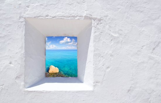 Ibiza mediterranean white wall window with Formentera beach view